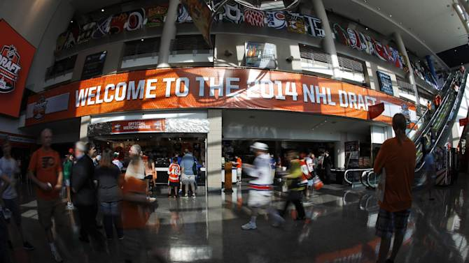 Fans gather inside the arena ahead of the first round of the NHL hockey draft, Friday, June 27, 2014, in Philadelphia