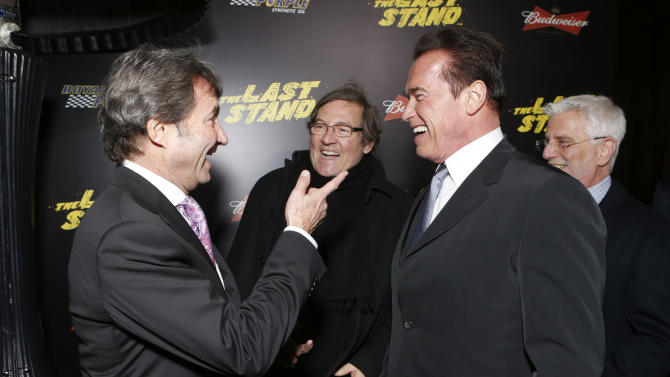 """Lionsgate Motion Picture Group President of Motion Picture Production and Development, Patrick Wachsberger, Producer Lorenzo di Bonaventura and Arnold Schwarzenegger attend the LA premiere of """"The Last Stand"""" at Grauman's Chinese Theatre on Monday, Jan. 14, 2013, in Los Angeles. (Photo by Todd Williamson/Invision/AP)"""
