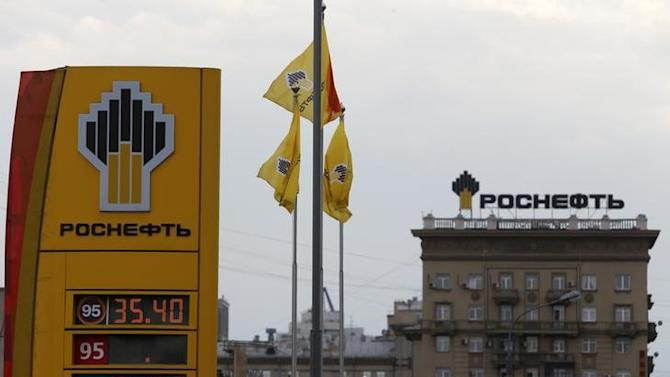 The logo of Russia's top crude producer Rosneft is seen on a price information board of a gasoline station in Moscow
