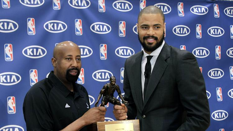 New York Knicks' Tyson Chandler, right, and Knicks head coach Mike Woodson pose for pictures with the trophy for the NBA's Defensive Player of the Year during a news conference in Tarrytown, N.Y., Wednesday, May 2, 2012. Chandler has been voted the NBA's Defensive Player of the Year.  (AP Photo/Seth Wenig)