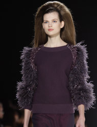 Fashion from the Fall 2012 collection of Carolina Herrera is modeled on Monday, Feb. 13, 2012 in New York. (AP Photo/Bebeto Matthews)