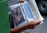 A man reads a newspaper showing Philippine boxing superstar Manny Pacquiao's World Boxing Organization (WBO) welterweight title bout against Timothy Bradley of the US in Manila on June 11, 2012. Nevada's state attorney general's office has found no wrongdoing by officials in Pacquiao's controversial loss to Tim Bradley on June 9, the Las Vegas Review-Journal reported Wednesday