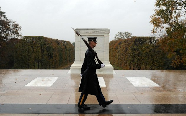 "This handout photo provided by the us Army shows Spc. Brett Hyde, Tomb Sentinel, 3d U.S. Infantry Regiment (The Old Guard), keeping guard over the Tomb of the Unknown Soldier during Hurricane Sandy, at Arlington National Cemetery, Va., Monday, Oct. 29, 2012. Just like the Sentinel's Creed says ""Through the years of diligence and praise and the discomfort of the elements, I will walk my tour in humble reverence to the best of my ability."" (AP Photo/Sgt. Jose A. Torres Jr.,/U.S. Army Photo)"