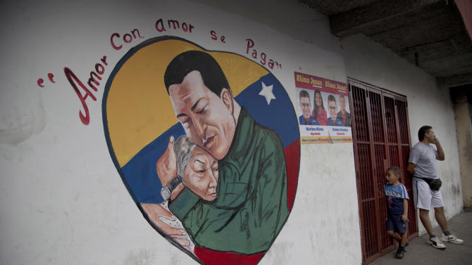 "A heart-shaped mural shows an image of Venezuela's President Hugo Chavez hugging a woman, in Caracas, Venezuela, Friday, Jan. 4, 2013. Chavez hasn't spoken publicly or been seen since his Dec. 11 operation in Cuba, and the latest report from his government Thursday night increased speculation that he is unlikely to attend his Jan. 10 inaugural ceremony. The message above the mural reads in Spanish; ""Love is repaid with love."" (AP Photo/Ariana Cubillos)"