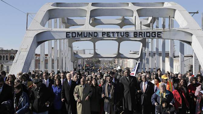 Vice President Joe Biden and U.S. Rep. John Lewis, D-Ga.,  lead a group across the Edmund Pettus Bridge in Selma, Ala., Sunday, March 3, 2013. They were commemorating the 48th anniversary of Bloody Sunday, when police officers beat marchers when they crossed the bridge on a march from Selma to Montgomery.(AP Photo/Dave Martin)