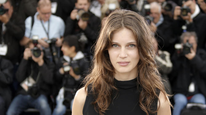 """File - In this May 16, 2013 file photo, actress Marine Vacth poses for photographers during a photo call for the film Young & Beautiful at the 66th international film festival, in Cannes, southern France. Cannes has been the birthplace of many a star, and the latest candidate to shine is Marine Vacth, who plays  in Francois Ozon's """"Young and Beautiful"""" (AP Photo/Francois Mori)"""