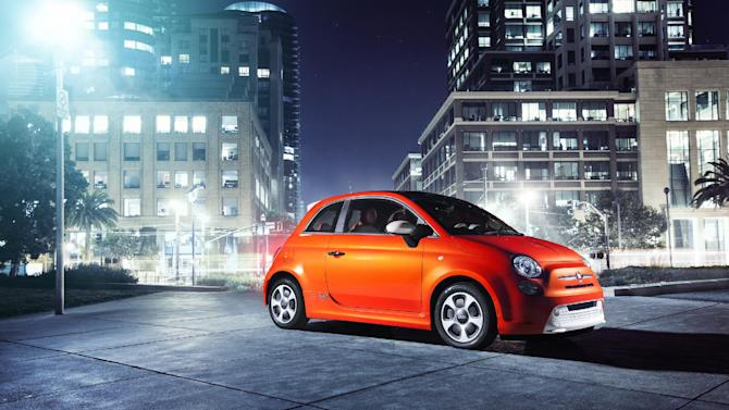 "This undated image provided by Fiat shows the 2013 Fiat 500e mini-car, which will be appearing at the Los Angeles Auto Show this week. The ""500e"" is the brand's first all-electric model in the U.S. while the ""500L"" comes with four doors and significantly more room than a regular model. The first 500 hit U.S. showrooms two years ago, promising a stylish and fuel-efficient remake of the 1950s original. But the car needs to boost its allure in the U.S., where sales remain pint-sized compared with the rest of the world. (AP Photo/Fiat)"