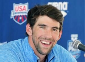 Michael Phelps launches comeback in 100 butterfly