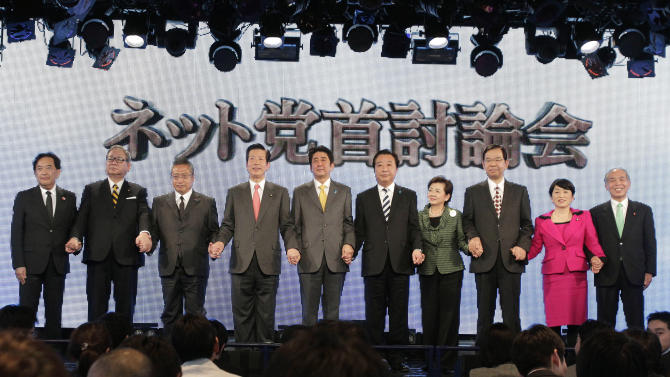 FILE - In this Nov. 29, 2012 file photo, Japanese Prime Minister Yoshihiko Noda, fifth from right, of the ruling Democratic Party of Japan, poses with nine other leaders of political parties after a debate for the Sunday, Dec. 16 parliamentary elections in Tokyo. Leaders are from left: Yasuo Tanaka of the New Party Nippon, Shozaburo Jimi of the People's New Party, Yoshimi Watanabe of Your Party, Natsuo Yamaguchi of the New Komeito Party, Shinzo Abe of the Liberal Democratic Party, Noda, Yukiko Kada of the Tomorrow Party, Kazuo Shii of the Japanese Communist Party, Mizuho Fukushima of the Social Democratic Party and Yoichi Masuzoe of the New Renaissance Party. Japanese letters on the screen read: Party Leaders' Debate on Internet. (AP Photo/Shizuo Kambayashi, File)