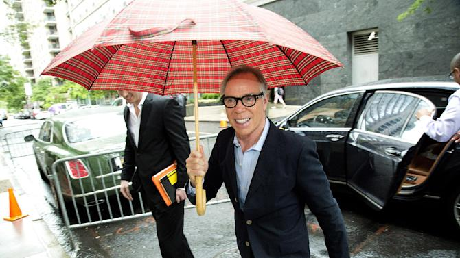 "This June 4, 2012 photo shows fashion designer Tommy Hilfiger arriving for rehearsals for the CFDA Awards in New York. Hilfiger has been in the fashion business for more than 40 years, starting at a little denim shop in Elmira, N.Y., and now at the helm of a brand that's one of the most recognizable in the world. This spring, he added ""American Idol"" style adviser to his resume. His peers at the Council of Fashion Designers of America honored him Monday night with a lifetime achievement award.  (AP Photo/Charles Sykes)"