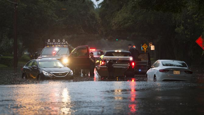 Georgetown Sheriff deputies check on motorists stalled along flooded Church Street in Georgetown
