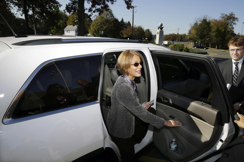 Democratic candidate for governor, Barbara Buono stops to answer a question as she leaves a campaign stop, in South Brunswick, N.J., Monday, Oct. 28, 2013. Buono will face popular Republican Gov. Chris Christie in an election Tuesday, Nov. 5, 2013. (AP Photo/Mel Evans)