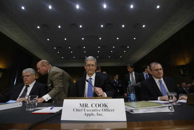 Apple CEO Tim Cook, Oppenheimer and Bullock appear before a Senate homeland security and governmental affairs investigations subcommittee hearing in Washington