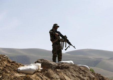 Afghan forces battle to push Taliban from southern highway