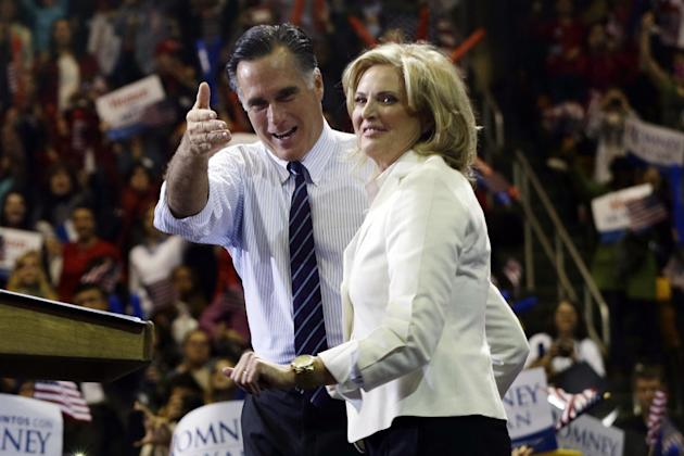 Republican presidential candidate and former Massachusetts Gov. Mitt Romney and wife Ann Romney stand on stage at a campaign rally at The Patriot Center at George Mason University in Fairfax, Va., Mon