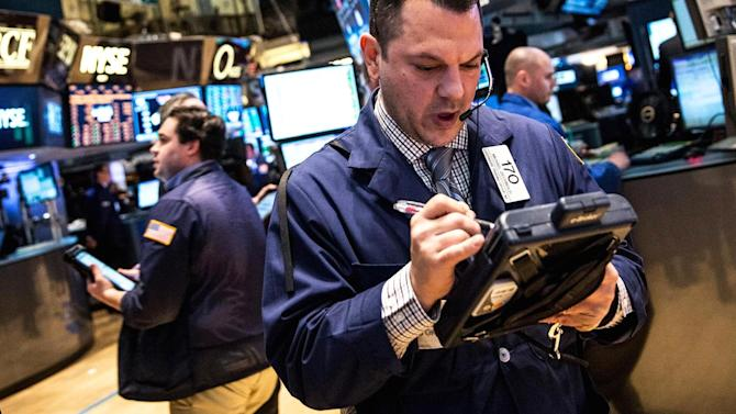 Early movers: KORS, BRK, GS, GM, MSFT, MCD & more