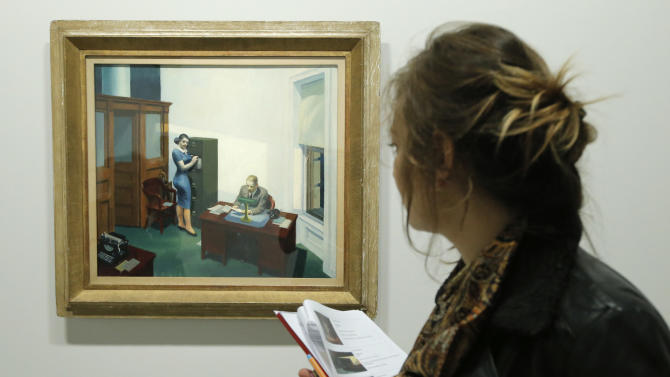 "A woman looks at ""Office at night, 1940"" as part of the retrospective of Edward Hopper works, one of the great American 20th century artists at Paris' Grand Palais Museum, in Paris, Monday, Oct. 8, 2012. This major Hopper retrospective reveals that the 20th century painter known for his rendering of American life, also drew inspiration from France, and includes some 128 Hopper works, such as the masterpieces ""Nighthawks"" and ""Soir Bleu"".(AP Photo/Francois Mori)"