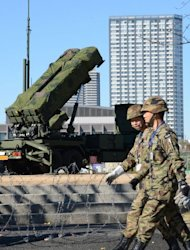 Officers of the Japanese Ground Self-Defense Force walk near a Patriot Advanced Capability-3 missile launcher outside the Defence Ministry in Tokyo on December 6, 2012. Japan said a missile fired by North Korea has passed over its southern island chain of Okinawa around 12 minutes after take-off