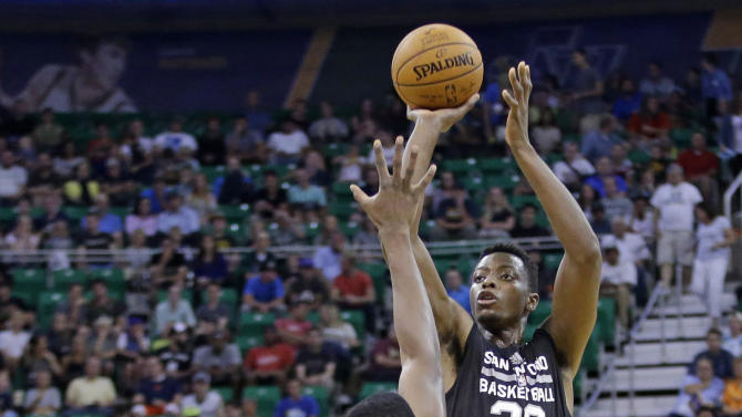 San Antonio Spurs' Cady Lalanne (26) shoots as Utah Jazz's JaJuan Johnson (81) defends during the first half of an NBA summer league basketball game Tuesday, July 7, 2015, in Salt Lake City. (AP Photo/Rick Bowmer)