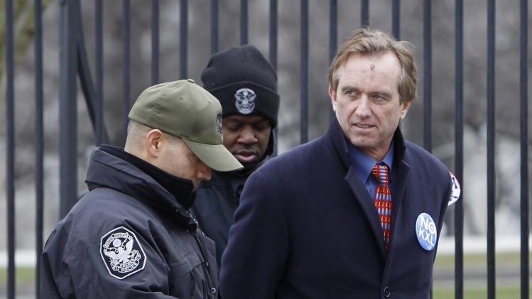 Robert F. Kennedy Jr. is arrested in Washington, Wednesday, Feb. 13, 2013, as prominent environmental leaders tied themselves to the White House gate to protest the Keystone XL oil pipeline. (AP Photo/Ann Heisenfelt)