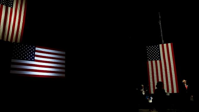 Workers stand backstage before the 2016 McIntyre Shaheen 100 Club Celebration with Democratic U.S. presidential candidates Bernie Sanders and Hillary Clinton at the Verizon Wireless Arena in Manchester, New Hampshire