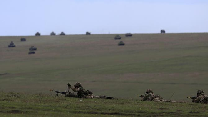"Soldiers and armoured vehicles take part in the ""Wind Spring 15"" military exercises at Smardan shooting range"