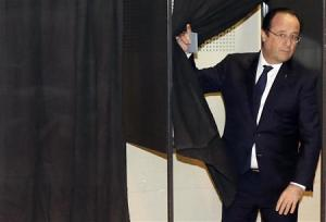 French President Francois Hollande leaves a polling booth before casting his ballot for the first round in the French mayoral elections at a polling station in Tulle