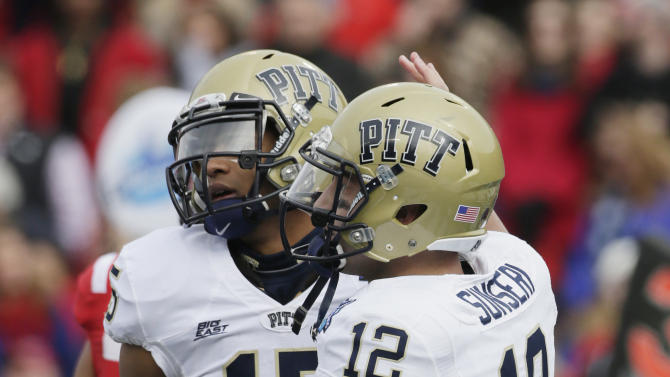 Pittsburgh quarterback Tino Sunseri (12) congratulates teammate Devin Street (15) after a touchdown reception  against Mississippi during in the first half of the BBVA Compass Bowl NCAA college football game at Legion Field in Birmingham, Saturday, Jan. 5, 2013. (AP Photo/Dave Martin)