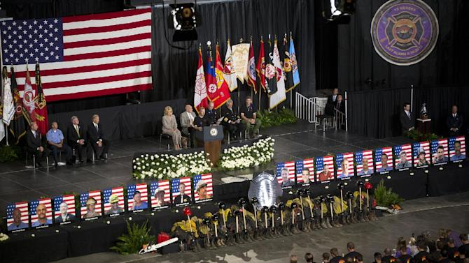 """Brendan McDonough recites The Hot Shot's Prayer during the """"Our Fallen Brothers"""" memorial service for the 19 fallen firefighters at Tim's Toyota Center in Prescott Valley, Ariz. on Tuesday, July 9, 2013. Prescott's Granite Mountain Hotshots were overrun by smoke and fire while battling a blaze on a ridge in Yarnell, about 80 miles northwest of Phoenix on June 30, 2013. (AP Photo/The Arizona Republic, David Wallace, Pool)"""
