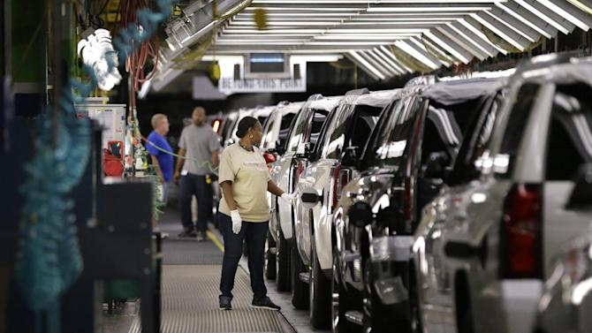 FILE - In this May 13, 2014 file photo, an auto worker inspects finished SUVs coming off the assembly line at the General Motors auto plant in Arlington, Texas. General Motors reports quarterly financial results on Thursday, July 24, 2014. (AP Photo/LM Otero, File)
