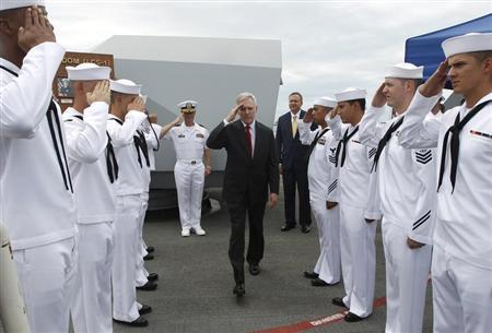 U.S. Secretary of the Navy Ray Mabus leaves the USS Freedom at Changi Naval Base in Singapore
