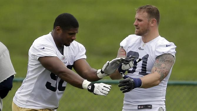 St. Louis Rams defensive ends Michael Sam, left, and Chris Long take part in a drill during an organized team activity at the NFL football team's practice facility Thursday, June 5, 2014, in St. Louis