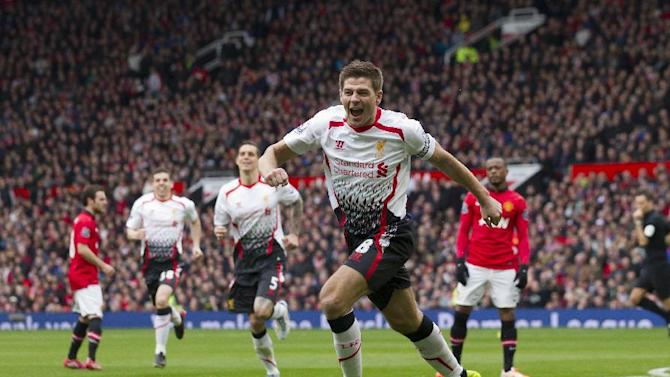Liverpool's Steven Gerrard celebrates after scoring against Manchester United during their English Premier League soccer match at Old Trafford Stadium, Manchester, England, Sunday March 16, 2014