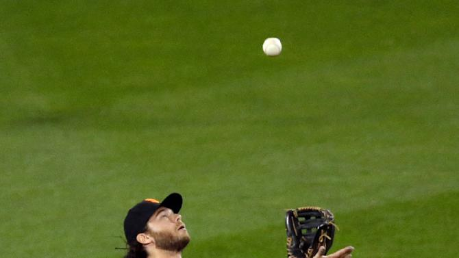 San Francisco Giants' Brandon Crawford catches a ball hit by Kansas City Royals' Omar Infante during the seventh inning of Game 1 of baseball's World Series Tuesday, Oct. 21, 2014, in Kansas City, Mo. (AP Photo/Jeff Roberson)