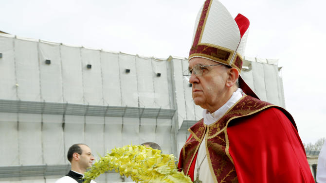 Pope Francis celebrates Palm Sunday Mass, in St. Peter's Square at the Vatican, Sunday, March 24, 2013.  Pope Francis celebrated his first Palm Sunday Mass in St. Peter's Square, encouraging people to be humble and young at heart, as tens of thousands joyfully waved olive branches and palm fronds. The square overflowed with some 250,000 pilgrims, tourists and Romans eager to join the new pope at the start of solemn Holy Week ceremonies, which lead up to Easter, Christianity's most important day. (AP Photo/Andrew Medichini)