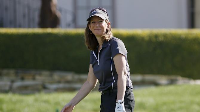Catherine Engelbert reacts to making her putt on the 11th green during the first round of the Pebble Beach Pro-Am golf tournament