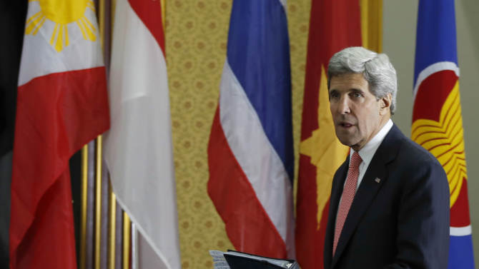 U.S. Secretary of State John Kerry arrives for a press conference at the ASEAN meeting in the International Conference Center in Bandar Seri Begawan, Brunei, Monday, July 1, 2013. Kerry swapped his Mideast peace portfolio for issues in emerging Southeast Asia and road bumps in U.S. relations with Russia and China when he landed Monday in Brunei for a regional security conference. (AP Photo/Vincent Thian)
