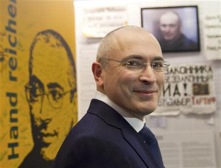 Freed Russian former oil tycoon Khodorkovsky smiles as he visits an exhibition in the Museum Haus am Checkpoint Charlie in Berlin
