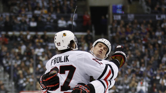 Chicago Blackhawks' Michael Frolik, left, celebrates his goal with Sheldon Brookbank during the first period of an NHL hockey game against the Los Angeles Kings in Los Angeles, Saturday, Jan. 19, 2013. (AP Photo/Jae C. Hong)