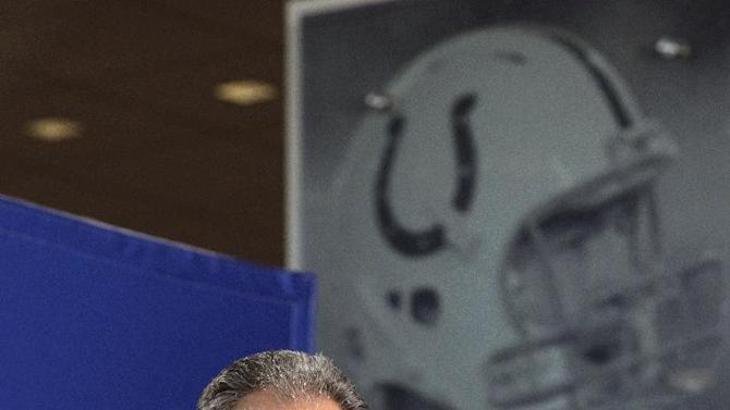 Indianapolis Colts head coach Chuck Pagano speaks in front of a large photograph of Colts quarterback Peyton Manning during a news conference at the NFL football scouting combine in Indianapolis, Thursday, Feb. 23, 2012. (AP Photo/Michael Conroy)