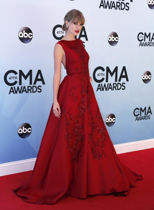 Taylor Swift poses on arrival at the 47th Country Music Association Awards in Nashville