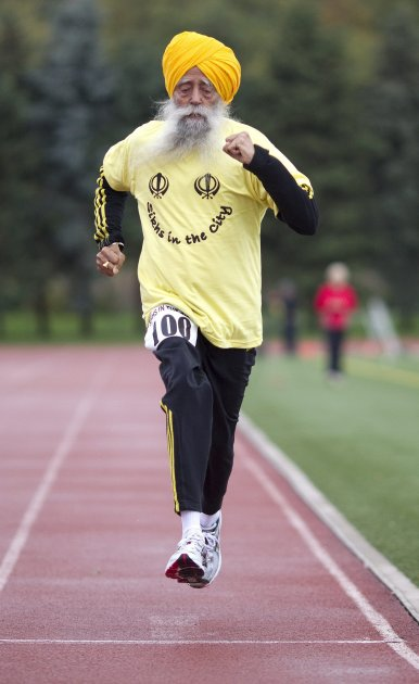 Centenarian Fauja Singh crosses the finish line in a 100 meter race for centenarians in Toronto,  Thursday Oct. 13, 2011.  One-hundred-year-old Singh, originally from India now living in London,  Engl
