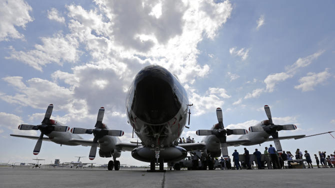 Visitors line up to tour the National Oceanic and Atmospheric Administration's WP-3D Orion turboprop 'Hurricane Hunter' at New Orleans Lakefront Airport in New Orleans, Wednesday, May 21, 2014. The aircraft is used by scientists on research missions to study various elements of a hurricane, flying through the eye of the storm several times each flight. The plane is also visiting Corpus Christi, Texas, Houston, Tallahassee, Fla.; and Tampa, Fla. (AP Photo/Gerald Herbert)