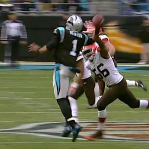 Cleveland Browns defensive lineman Billy Winn intercepts Carolina Panthers quarterback Cam Newton