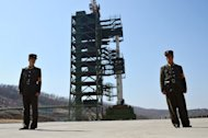 Two North Korean soldiers stand guard in front of a Unha-3 rocket at Tangachai -ri space center in April 2012. With North Korea seemingly intent on going ahead with its planned rocket launch, the international community must decide how it can punish a country that has proved largely impervious to past sanctions