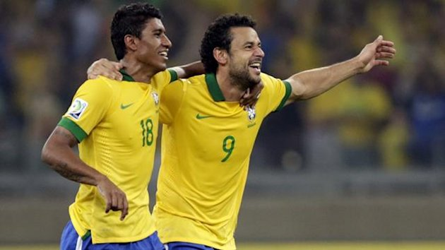 Brazil's Paulinho (L) and Fred celebrate after their Confederations Cup semi-final soccer match against Uruguay at the Estadio Mineirao in Belo Horizonte June 26, 2013. (Reuters)