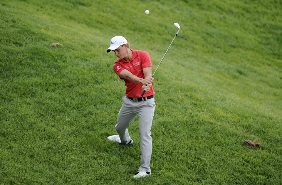 Bud Cauley hits from the rough on the second hole during the first round of the AT&T National golf tournament, Thursday, July 27, 2013, in Bethesda, Md. (AP Photo/Nick Wass)