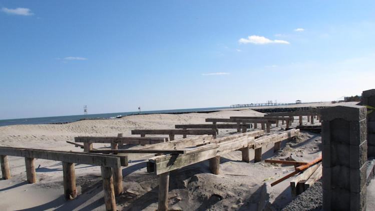 In this Feb. 12, 2013 photo, support pilings and damaged concrete are all that is left of the Avon, N.J. boardwalk, which was destroyed by Superstorm Sandy.Dogged by legal and environmental woes, Avon is lagging behind some other Jersey shore towns in terms of  quickly rebuilding storm-damaged boardwalks. (AP Photo/Wayne Parry)