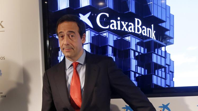Caixabank Chief Executive Gonzalo Gortazar stands before reporting second-quarter results at La Caixa headquarters in Barcelona