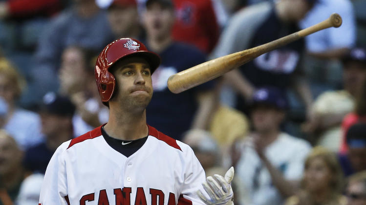 Canada's Taylor Green (5) flips his bat in the air after striking out in the seventh inning during a World Baseball Classic baseball game against the United States on Sunday, March 10, 2013, in Phoenix.  The United States defeated Canada 9-4. (AP Photo/Ross D. Franklin)